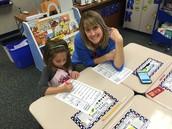 Mrs. Sutton & Kylie working hard on Fluency!