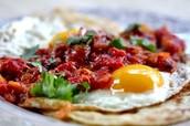 Huevos rancheros (Doscientos cincuenta y tres pesos-253)