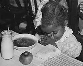 Girl Praying before eating her meal