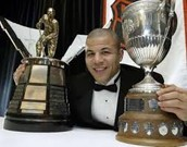 Iginla with the Maurice Richard trophy, and the Western Conference trophy