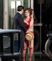 Tom and Myrtle seen at husbands car shop