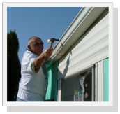 Bruce, RSVP Volunteer, helps fix gutters during Make a Difference Day.