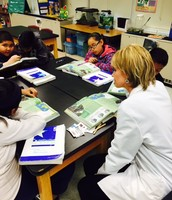 Ms. Kelly works with small group instruction in the Science lab!