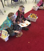 Mrs. Zucchi's class - partner reading on the 100th day of school