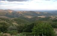 Rolling hills around Castel Rigone.