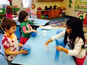 Isabella, Willa, and Bryan sharing and working together on their globes.