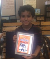 Gabriel showing off a book he recommends to kids that like comedy.