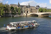 People in Paris ride in boats for fun.