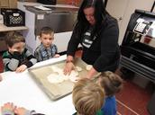 Mrs. Fischer making a gingerbread...