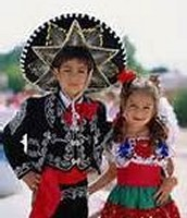 Little kids are dress up in Mexico cloths.
