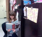 Eva reading Robinson Crusoe as Child Scroog