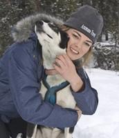 Rachel Scordis with one of her racing dogs.
