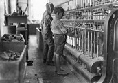 little boy working on an factory