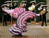 Dancing to a song played by the mariachi band