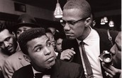 Muhammad Ali speaks with Malcom X in conference of Nation of Islam