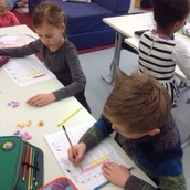 1a - creating bar graphs, using tally marks and answering related questions to the bar graph using Valentin's Day hearts