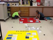 Gluing the titles, information, and pictures.