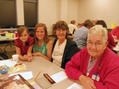 Community members play  Scrabble®, raise funds and promote literacy awareness.