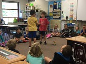 Mrs. Weikle's classmates practicing a good handshake with eye contact.