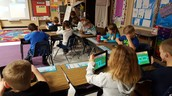 Students practice simple coding with the Kodable app.