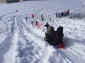 EW teachers sledding with the kids!