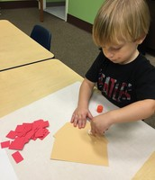 Alex helps build our class brick house for the three little pigs.
