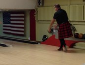 Man in a kilt bowling!
