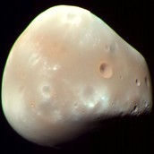One of the moons for Mars (Deimos)