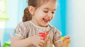 Child using scissors