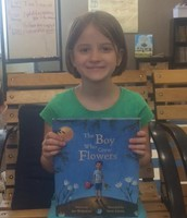 Gretchen showing off a book she loves because it inspires her!