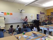 Mr. Taggart reads aloud to his fourth graders