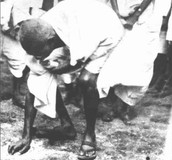 Gandhi making salt on the beaches of India