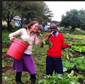 Student and teacher in the Orkeeswa school garden