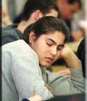 A student falling asleep in class.