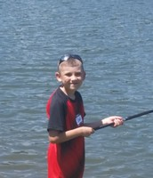 James poses for a quick picture while fishing