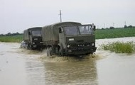 Military trucks in flood waters