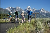 Ride mountain bikes with your family