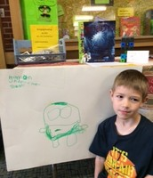 Harrison with his robot poster