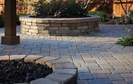 Pavers can make a nice transition to natural areas.