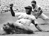 Jackie Robinson playing  Baseball