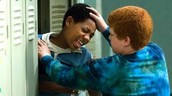 A white boy bullying a black boy.