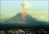 Volcano Mayon erupting
