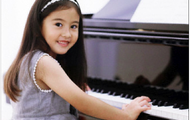 Jing-mei at piano lessons.