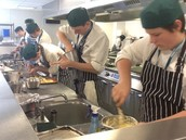 Students in The Kitchen displaying high professional standards