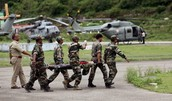 Soldiers Taking Injured People to Hospitals Via Helicopters
