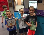 KIndergarteners checking out library books
