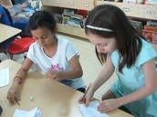 Rolling dice, drawing a circle, rolling again, and making stars in the circle