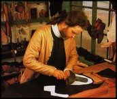 A shoemaker making shoes