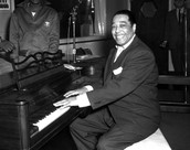 Ellington poses with his piano at the KFG Radio Studio November 3, 1954.