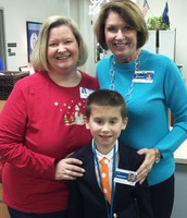 Beginning the day with mom, Mrs. Libby Tucker, Principal Fickling and Principal for the Day, Mr. Jonathan Tucker